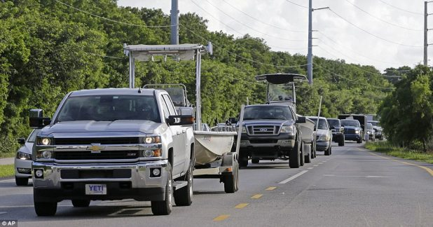 Motorists head north on US Route 1 as Hurricane Irma moves its path in the northeast Caribbean on Tuesday in Key Largo, Florida. The Florida Keys are currently under a mandatory evacuation