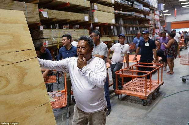 People purchase plywood at The Home Depot as they prepare for Hurricane Irma on September 6, 2017 in Miami, Florida