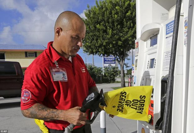 Gas station employee Albert Fernandez covers a pump after running out of gas on Wednesday in Key Largo, Florida as the demand for gas has increased due to Hurricane Irma
