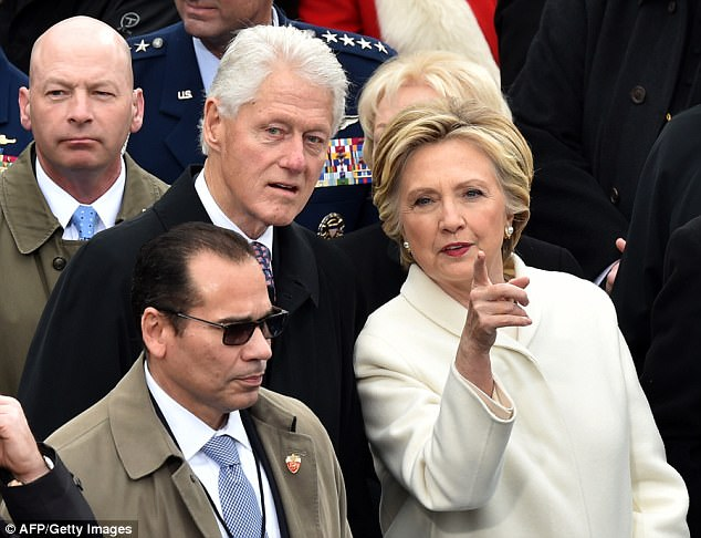Hillary Clinton pointed the finger at passionate anti-Trump supporters who attended a women's march after her historic loss