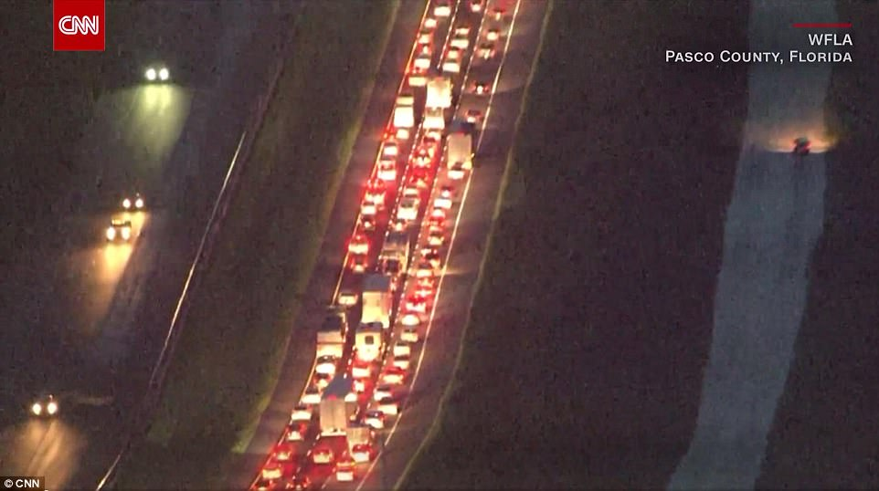 Traffic was banked up in Pasco County, Florida late on Thursday night as residents evacuated the state
