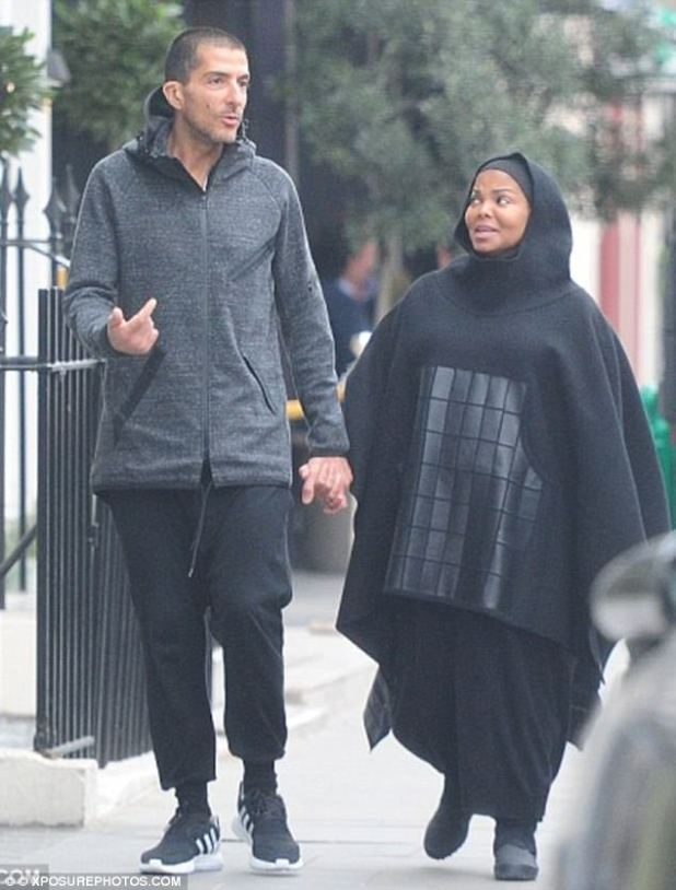 Transformation: The singer pictured wearing a poncho while stepping out with estranged husband Wissam Al Mana back in January