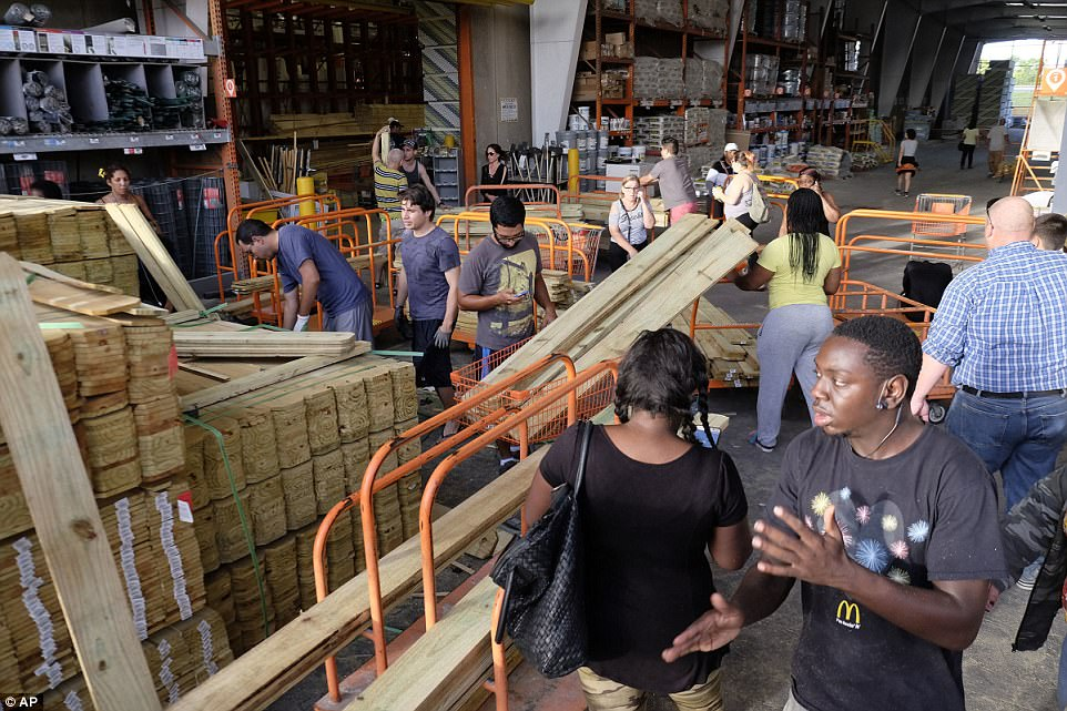 Customers at a Home Depot buy wood to secure their property in anticipation of Hurricane Irma early Friday in Miami, Florida
