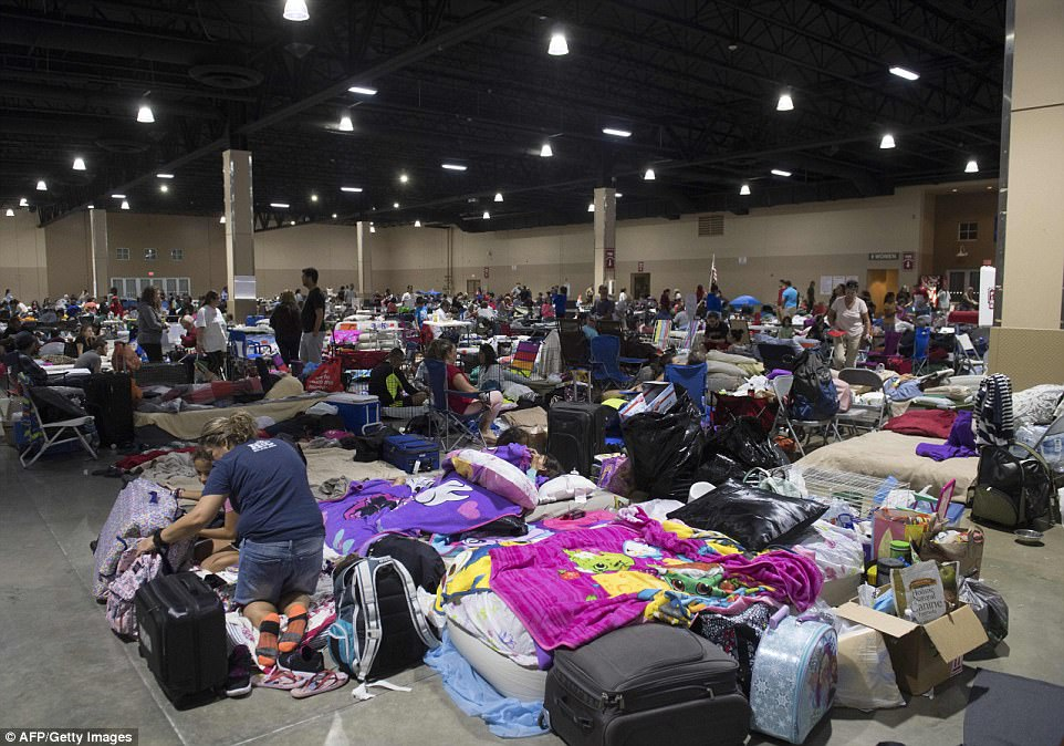 Hundreds of people gather in an emergency shelter at the Miami-Dade County Fair Expo Center in Miami, Florida on Friday