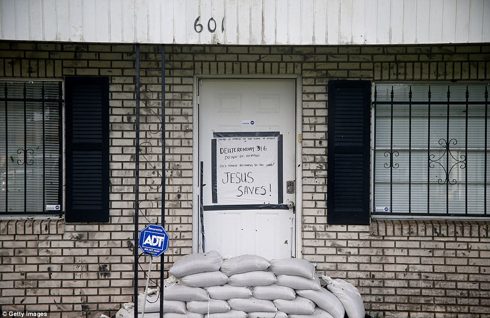 A home with a religious message taped to the front door sits apparently undamaged just hours after Hurricane Irma passed through the area on September 11, 2017 in Fort Meade, Florida