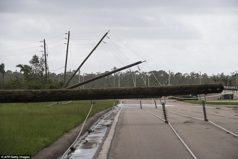 Downed power lines are seen in Bonita Springs, Florida, northeast of Naples, on September 11, 2017 after Hurricane Irma hit Florida
