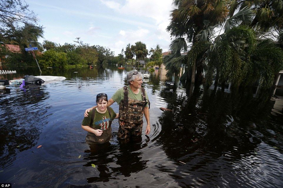 Kelly McClenthen returns to see the flood damage to her home with her boyfriend Daniel Harrison in the aftermath of Hurricane Irma in Bonita Springs, Fla., Monday, Sept. 11, 2017