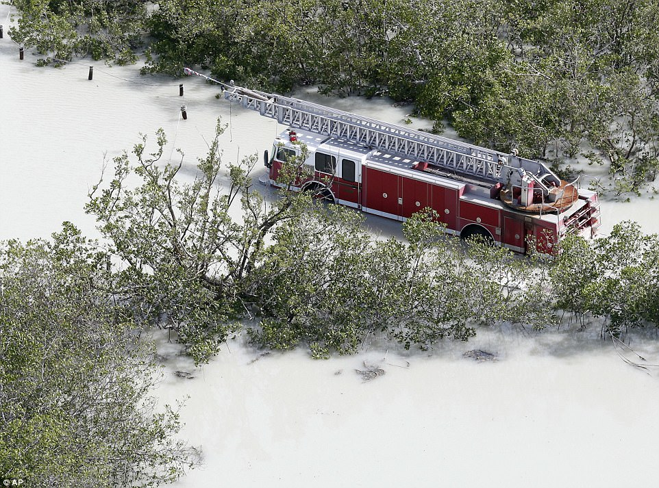 A fire truck is shown in a flooded area in the wake of Hurricane Irma on Monday in Key Largo, Florida