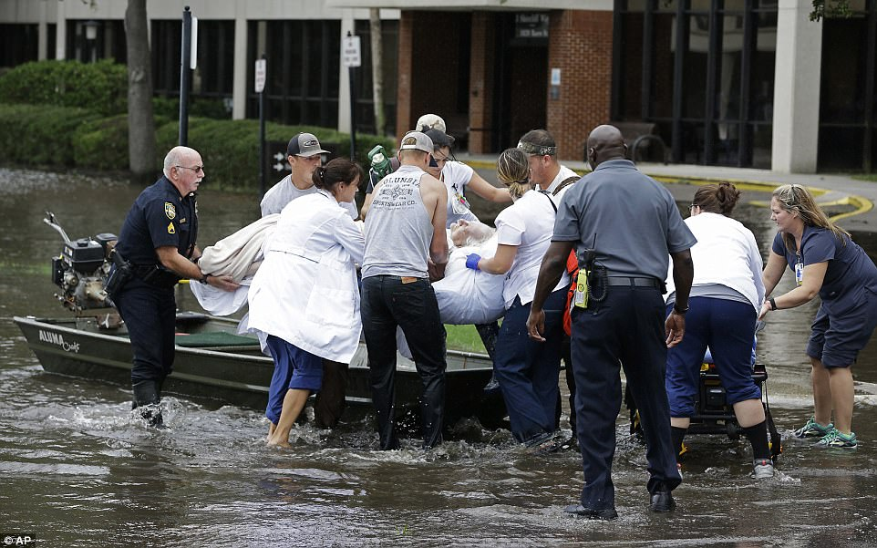 A patient is evacuated by boat from the St. Vincent's Medical Center after floodwaters from Hurricane Irma covered the first floor of the hospital in Jacksonville, Florida, Monday, Sept. 11, 2017