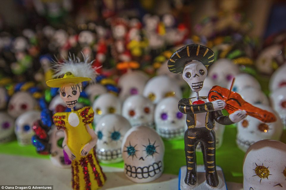 Day of the Dead souvenirs in Oaxaca, Mexico. The festival originated as an Aztec tradition in Mexico, celebrating the lives of the deceased through preparing sugar skulls, marigolds and their favourite food and drinks over three days