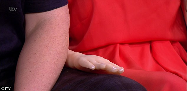 Arran repeatedly touched the doll's leg and arm throughout the interview as he explained how he hopes the doll will 'help people' rather than 'replace women'