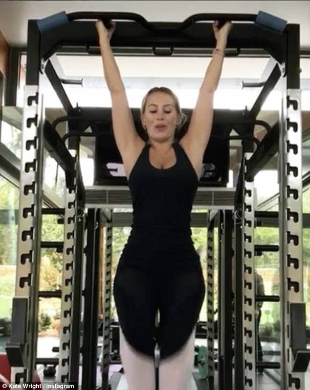 Strong: The previous day Kate proved her strength during her gym session by hoisting herself on a pull-up bar