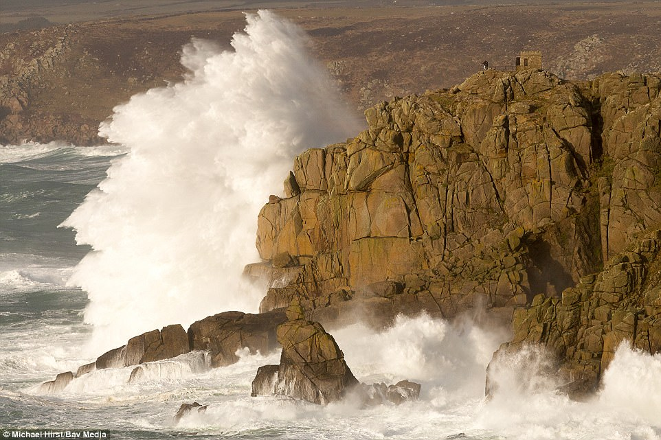 Explosive: Waves crash on the rocks at Sennen in Cornwall. The shot was taken by Michael Hirst, from Cornwall