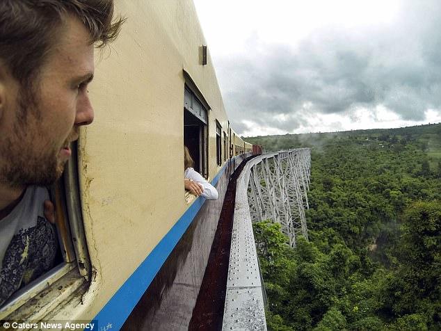 The avid adventurer was then stuck in rebel territory for 36 hours whilst the locals used wooden planks to try and put the train back on the tracks