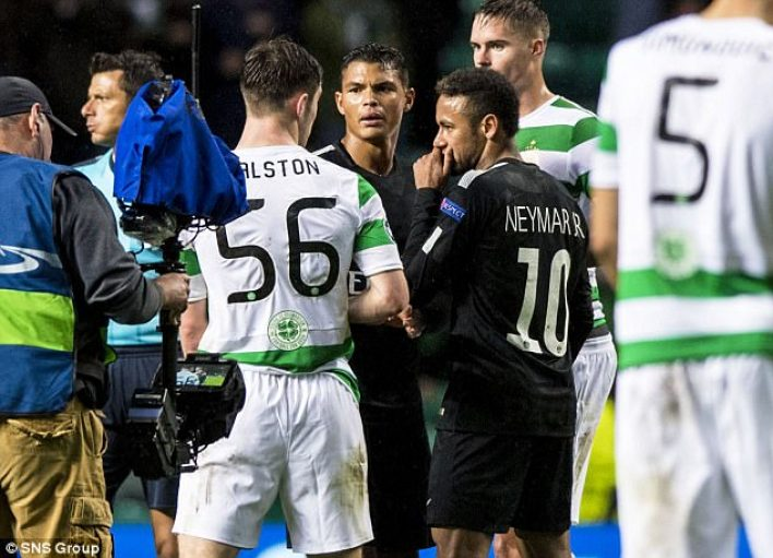 The Paris Saint-Germain star exchanges words with the Celtic defender after the match
