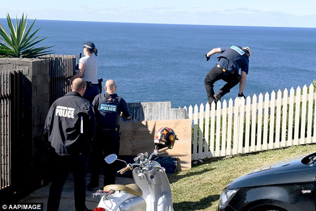 Australian Federal Police officers search the home of nightclub identity and former Kings Cross doorman John Ibrahim at Dover Heights, in Sydney's eastern suburbs, on August 8