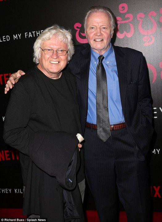 Pals: Father Jon, 78, looked dapper in a classic midnight blue suit which he paired with a lighter blue shirt and carbon crosshatch tie (seen here with musician Chip Taylor