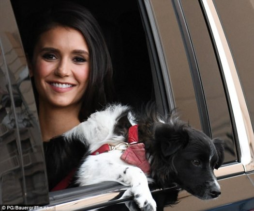 Cute smile: The Vampire Diaries star flashed a cute smile while riding with her dog
