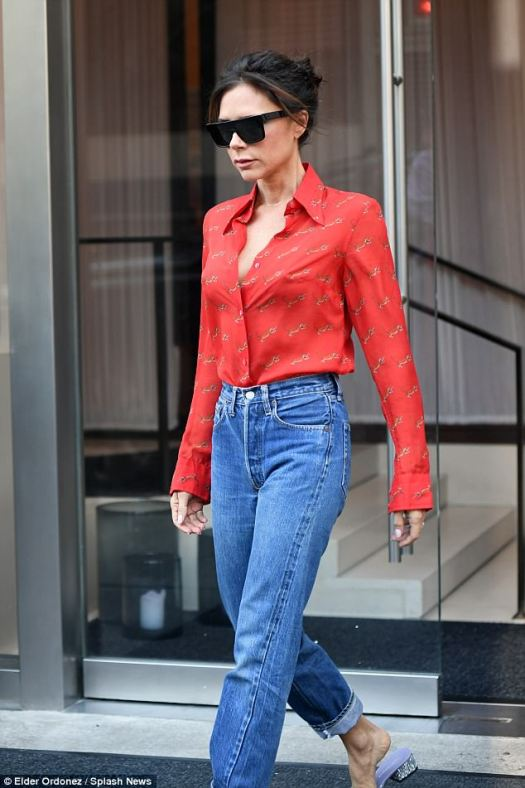 Effortless:The former singer certainly caught attention in the classically glamorous ensemble, which saw her team together a stunning silk shirt with trendy boyfriend jeans