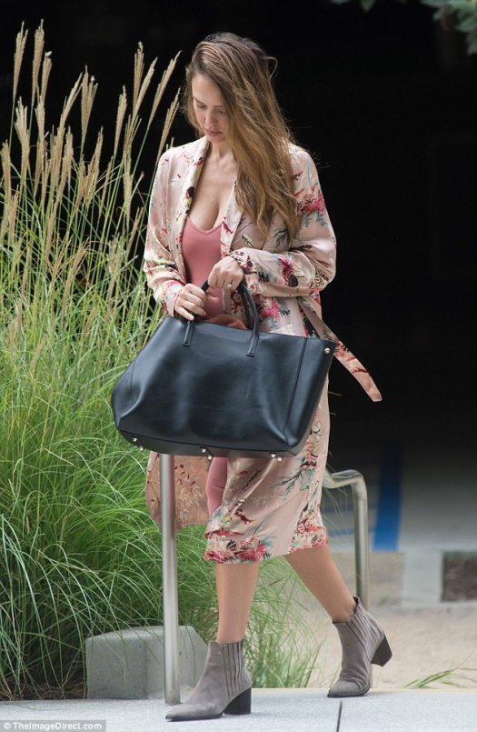 What a beauty: The stunning actress, 36, wowed in a rose colored dress with a floral kimono on Thursday in Los Angeles