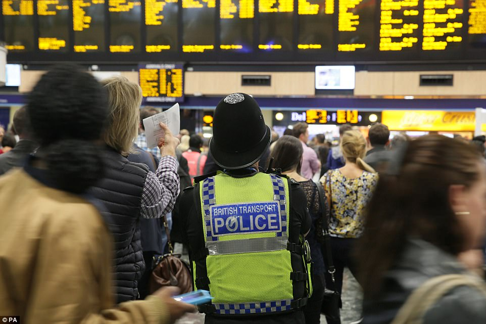 Security was stepped up at stations around London following this morning's attack. Pictured is a British Transport Police officers at Euston