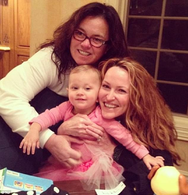 Happy days:Rounds was the adoptive mother of O'Donnell's youngest daughter Dakota, 4, but lost custody of the girl in 2015 (Rounds and O'Donnell above with Dakota in January 2014)