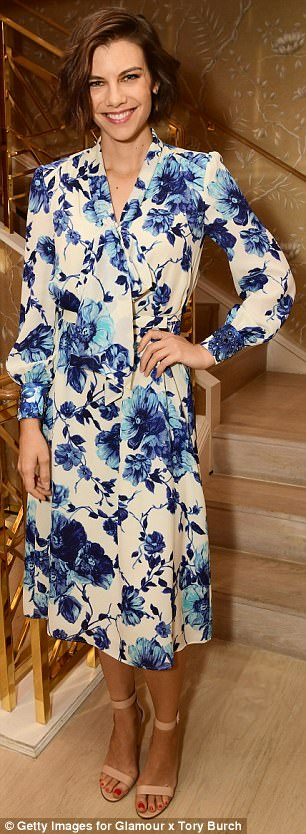 Lauren Cohan kept the side up with florals, in an elegant wedgewood blue and white dress