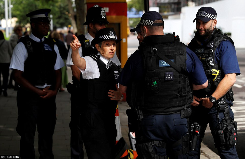 The crime commissioner chats with armed police officers who have been deployed around the city in the wake of the failed bombing at Parsons Green tube station yesterday