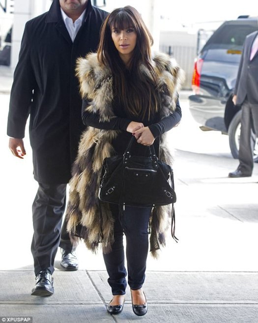 Fur real? Kim was seen with this fur vest in New York City in 2013