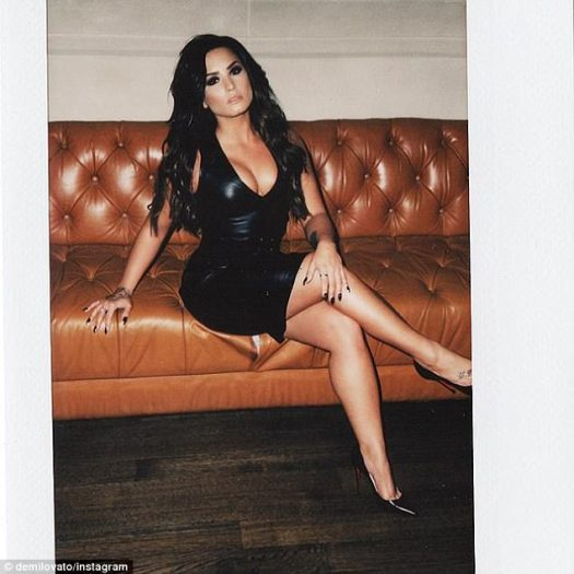 Sofa so good: She looked smoking hot as she showcased her stunning figure, in the form fitting outfit, which clung to every curve