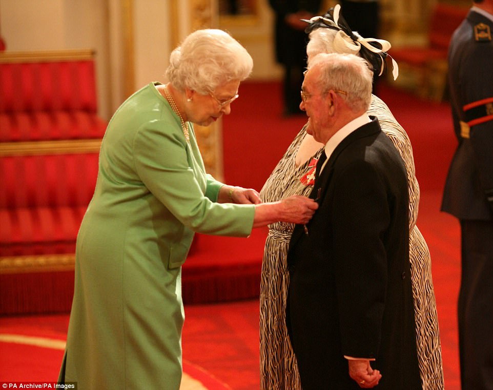 Ronald and Penelope Jones receive MBEs from the Queen in 2009 for fostering hundreds of children. The couple own the house in Sunbury-on-Thames that has been raidedalthough it is not known if they or any of their foster children still live there