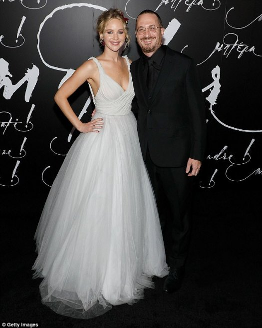 Gorgeous in a white gown: Jennifer, 27, and her director beau Darren Aronofsky, 48, at the New York premiere of Mother! on Wednesday