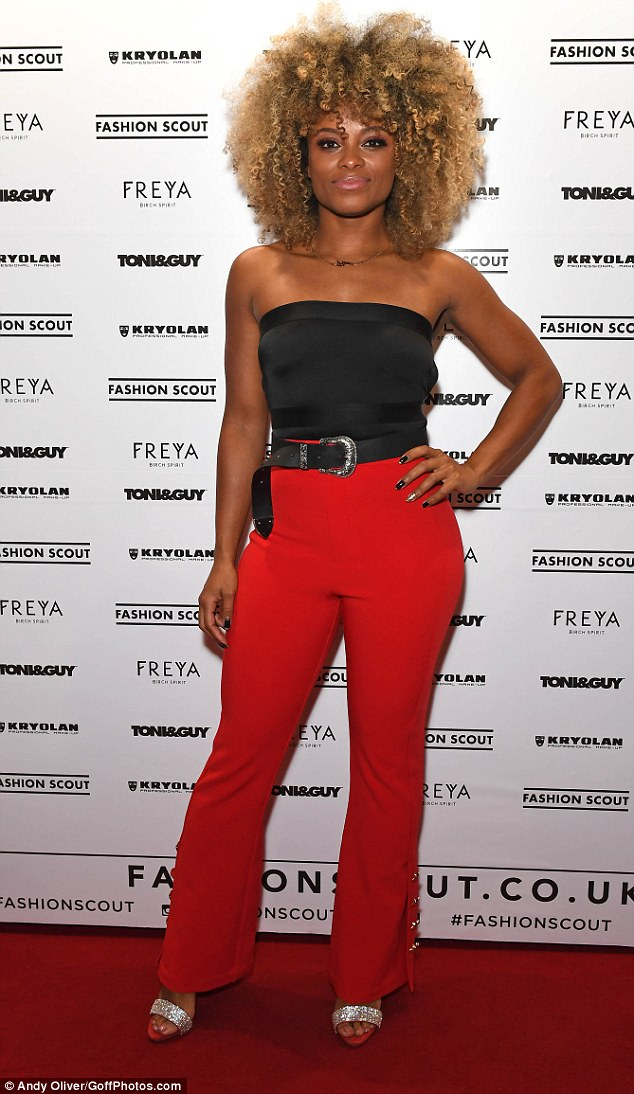 Scarlet siren: X Factor star Fleur East stole the limelight in a pair of sizzling flared trousers
