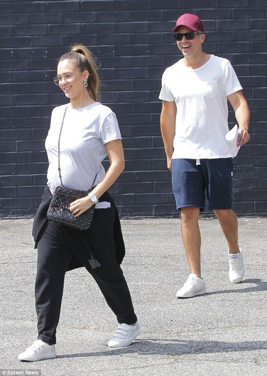 Happy family: Alba and Warren have been together since meeting on the set of Fantastic Four in 2004