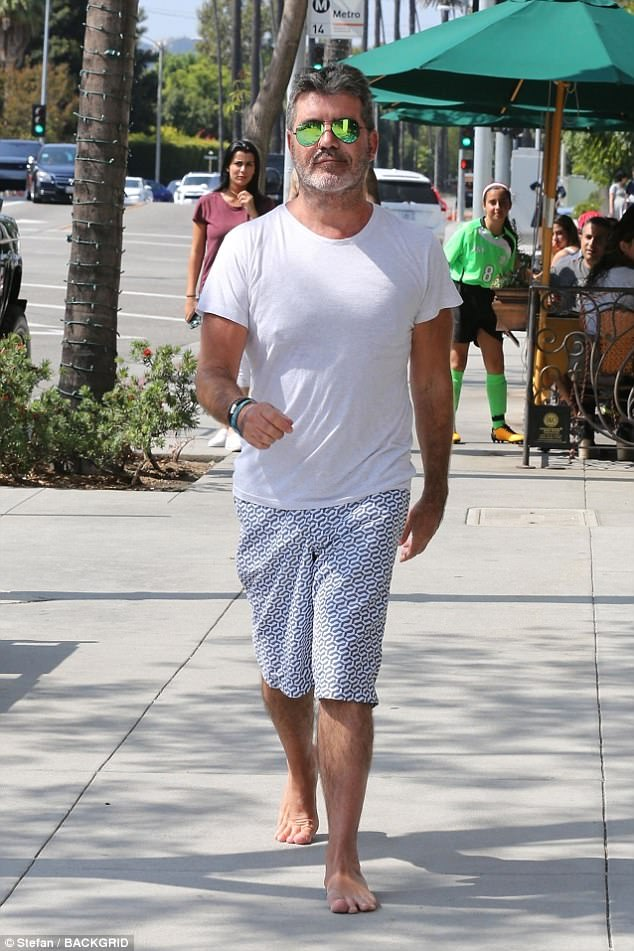 Toe-tally weird:The X Factor head judge, 57, seemed unfazed by his lack of footwear as he enjoyed a shopping trip with his stunning girlfriend, Lauren Silverman, 40