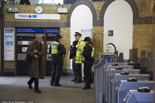 Passengers were pictured going through the turnstiles less than 24 hours after the bomb exploded at the station on Friday
