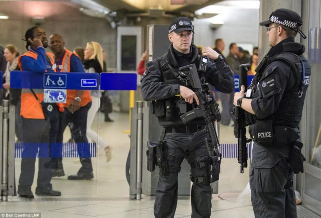 Armed officers on patrol at a busy Westminster station this morning - Scotland Yard said the arrest will lead to more activity from officers