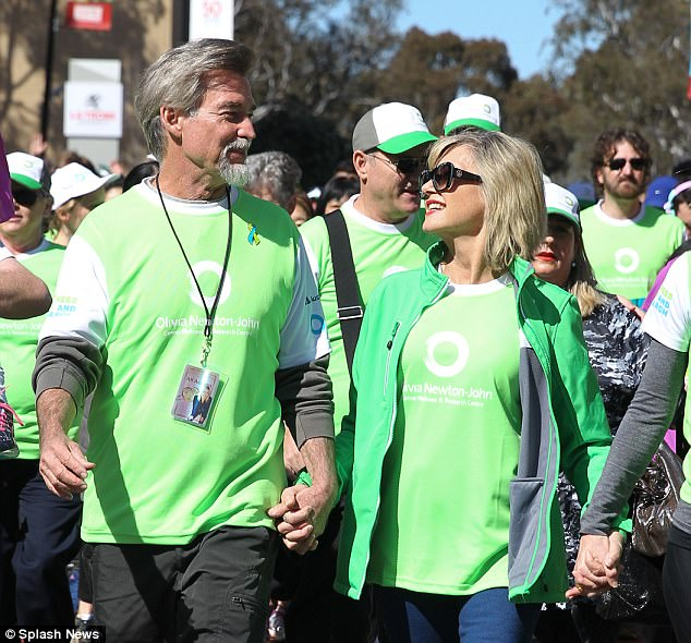 Strong bond: Olivia was joined on the walk by husband John Easterling and the pair looked smitten as they walked for the good cause