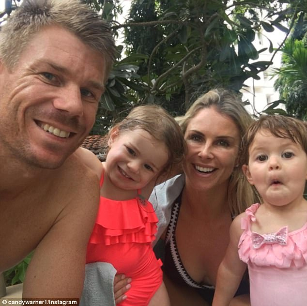 Close unit: Candice Warner was very much in a family frame of mind on Saturday when her and husband David shared a series of cute poolside photos while on vacation in Chennai, India
