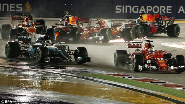 Vettel was able to continue but lost control of his Ferrari and spun out on turn five