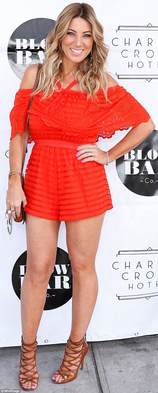 Woman in red: Amber was joined at the event by journalist Jo Casamento who looked stunning in a skimpy bright red playsuit