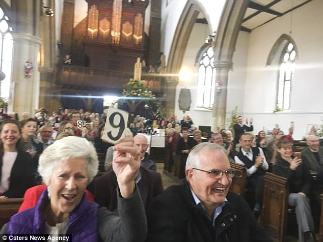 Thrilled: They were even dished out scoring paddles to mark their parish vicar, with 9s and 10s cropping up amid the flock