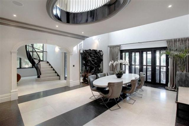 A large downstairs dining area leads on to a sweeping staircase and up on to the first and second floors, where each of the bedrooms and their en-suite bathrooms are located
