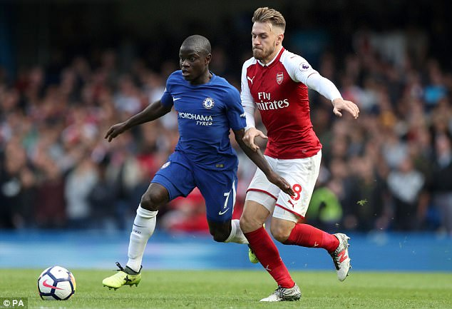 N'Golo Kante looks to break clear from the attentions of Aaron Ramsey during the contest