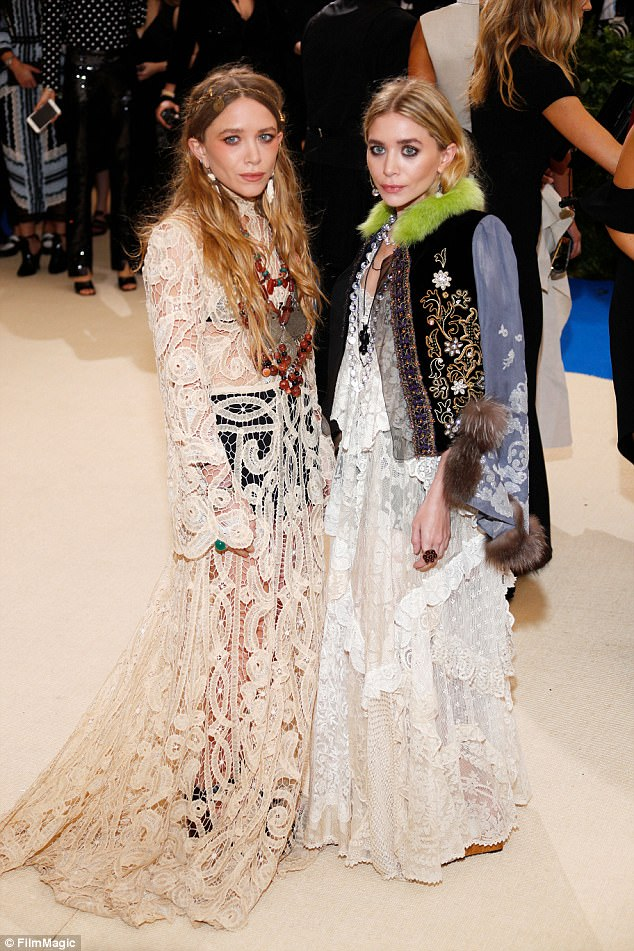 The others: Her sister Mary Kate and Ashley Olsen in May in NYC
