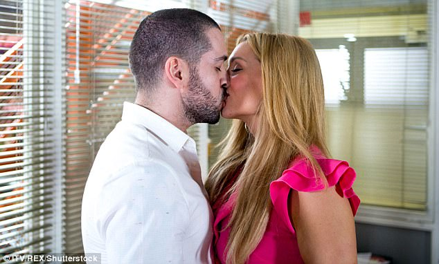 Raunchy:The playful former X Factor champion told The Sun : 'I¿m not going to complain. My character has had an affair for a year. It¿s been a lot of fun' (pictured above kissing Catherine Tyldesley who plays Aidan's fiancee Eva Price)