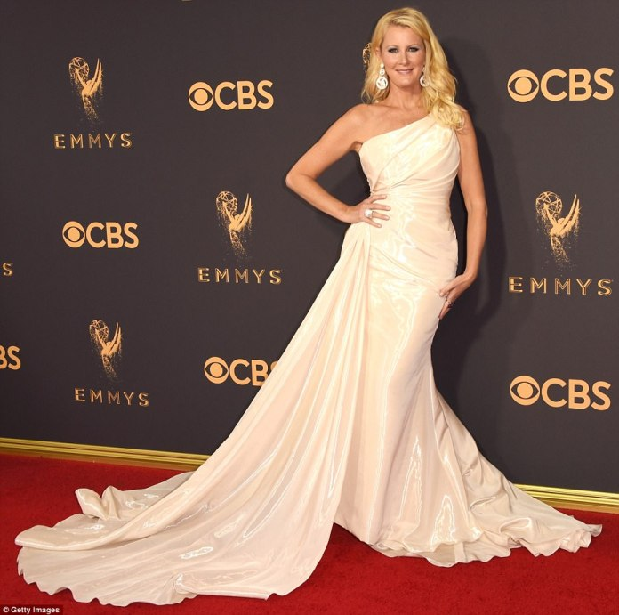 Shiny shocker: TV chef Sandra Lee looked more like she was preparing to walk down the aisle than the red carpet in this shimmering white number