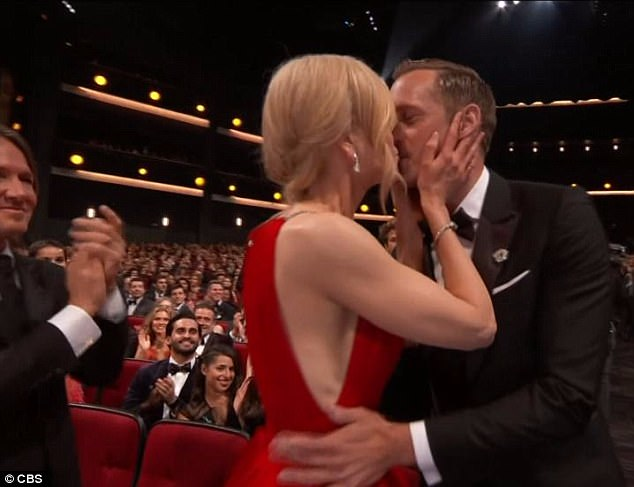 That's not your husband! After Alexander Skarsgård (right) won an Emmy for his role in Big Little Lies, co-star Nicole Kidman (centre) gave him a kiss on the lips... as real-life husband Keith Urban (left) watched on beside them