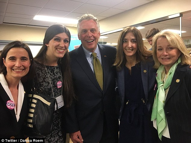 Prepared: Roam has a good grasp on her opponent's record which she reported on for years and is refusing to debate her (pictured with volunteers and Virginia governorTerry McAuliffe)