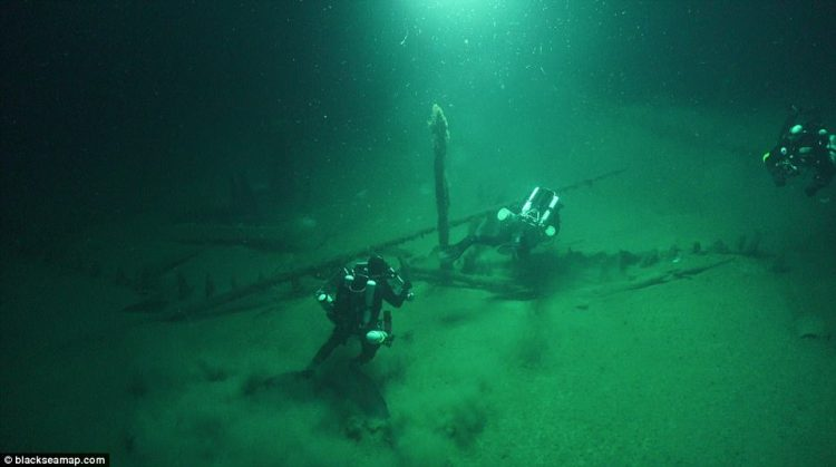 Scientists have accidentally discovered a graveyard of ancient shipwrecks while using underwater Remotely Operated Vehicles to survey the effects of climate change along the Bulgarian coast. Pictured are researchers exploring a recently discovered 2,000-year-old Roman galley buried in the seabed